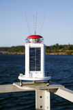 Solar Panels Powering Navigational Light Marina Stock Photo