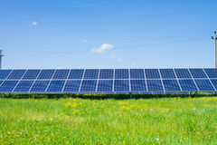 Solar panels produces green Royalty Free Stock Photos