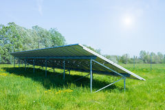 Solar panels produces green Royalty Free Stock Images