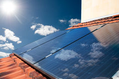 Solar panels producing energy. Solar panels producing electricity on a sunny day Stock Photo