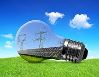 Solar panels with pylons in light bulb. Green energy concept Stock Image