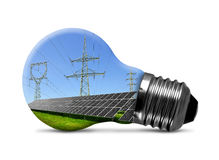 Solar panels with pylons in light bulb Stock Image