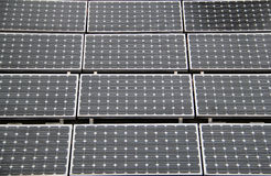 Solar Panels. Rectangular solar panels on a roof top Stock Images