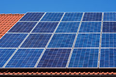Solar Panels on the Red House Roof. Solar Energy Background. Royalty Free Stock Photo