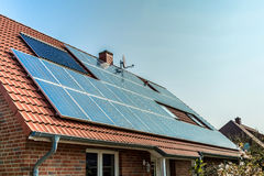 Solar panels on a red roof Stock Photo