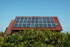 Solar panels on a red roof Stock Images