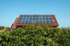 Solar panels on a red roof Stock Image