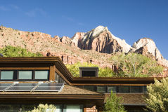 Solar panels on roof 1. Solar panels attached to the roof of the visitor's center in Zion National Park in southwest Utah. Sandstone formations in the background Royalty Free Stock Image