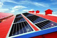 Solar panels on the roof. Red roof in solar panels. Green energy is universal. Reflected in every corner of our lives Royalty Free Stock Image