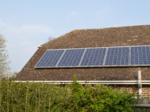 Solar Panels on Roof. Domestic solar panels on house roof, a source of alternative energy and income from surplus electricity Stock Photo