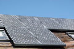 Solar Panels. On a roof against an azure blue sky Stock Photo