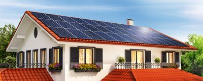 Solar panels on the red roof of a beautiful house and clear sky stock photos