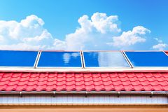 Solar panels on the roof. With blue sky and clouds Stock Images