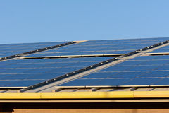 Solar panels on roof of building Stock Photo