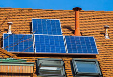Solar panels on the roof of a building Stock Photos