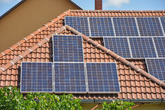 Solar panels on the roof of a building. In summer Royalty Free Stock Photos