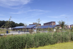 Solar panels on roof of car parking at water campus leeuwarden i. N the  netherlands under blue sky Royalty Free Stock Image