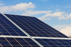 Solar panels. A roof with solar panels cells - detail. Solar panels producing clean and sustainable electricity. Solar panels against a serene blue sky Stock Photo