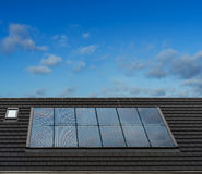 Solar Panels on roof of English Style Architecture House, UK Stock Photo