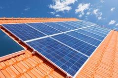 Solar panels on roof. Green renewable energy with photovoltaic solar panels on roof Stock Photography
