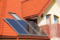 Solar panels on roof of house. Solar panels on roof of modern family house. REnewable energy source Royalty Free Stock Photo