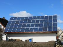 Solar panels on house. Solar panels on roof of house against blue skies on sunny day Stock Photography
