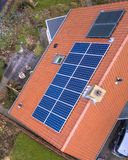 Solar panels on house roof. Solar panels on roof of house seen from above Royalty Free Stock Image