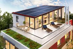 Solar panels on the roof of the house. And terrace stock images