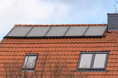 Solar panels on the roof. Image of solar panels on the roof Royalty Free Stock Image