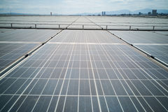 Solar panels on roof of industial building generate electricity Stock Photos