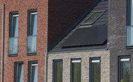 Solar panels on the roof of a new build house for durable green energy. Solar panels on the roof of a house / photovoltaics on domestic home Stock Photo