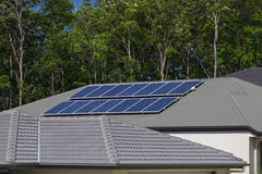Solar panels on roof. Solar photovoltaic panels installed on tiled roof Royalty Free Stock Image