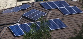 Solar panels on roof. Solar photovoltaic panels installed on tiled roof Royalty Free Stock Photos