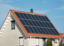 Solar panels on roof. Solar panels on a pitched roof of a house. Maximum return from the surface of the roof Royalty Free Stock Photos