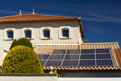 Solar panels on the roof of a private house. Royalty Free Stock Image