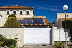 Solar panels on the roof of a private house. Solar panel located on the roof of a private house stock image