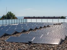 Solar panels on a roof for the production of environmentally fri stock images