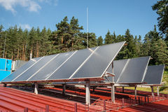 Solar panels on a roof. Solar panels on a red roof Stock Photo