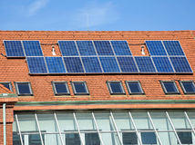 Solar panels on the roof of the school building Stock Images