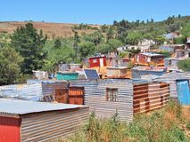 Solar panels on the roof of shack at Informal settlement in South Africa. Royalty Free Stock Photography