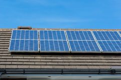 Solar energy panels on a roof Royalty Free Stock Images