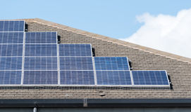 Solar energy panels on a Roof Stock Images