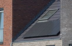Solar panels on a roof for sustainability. Solar panels on the roof of a house Royalty Free Stock Images