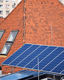 Solar panels and roof tiles Stock Photography