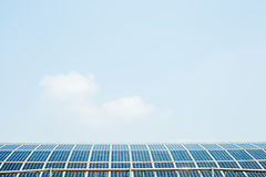 Solar panels on the roof under blue sky Stock Photo