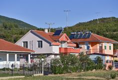 Solar panels on roofs royalty free stock photography
