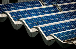 Solar panels on rooftop. Banks of solar panels on rooftop of a building. Scientific, Technology, and Engineering solution to tapping electrical energy from the Stock Photo