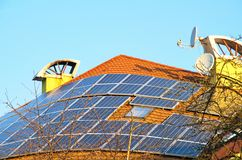 Solar panels on the rooftop. The solar panels installed on a roof of the private house stock images