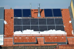Solar panels on a rooftop in winter Stock Image