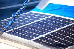 Solar panels in sailboat. Renewable eco energy Royalty Free Stock Images